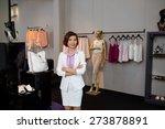 confident female boutique owner ... | Shutterstock . vector #273878891