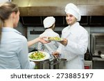 smiling cook gives to young... | Shutterstock . vector #273885197