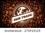 Small photo of Fair Trade graphic against heart indent in coffee beans