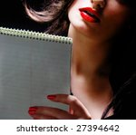 Businesswoman reading her notes - stock photo