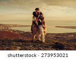 loving couple wrapped in plaid...   Shutterstock . vector #273953021