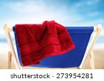 Red Towel On Blue Chair And...