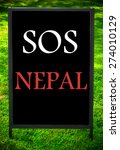 Sos Nepal  Message On Sidewalk...