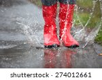 A Pair Of Red Rubber Boots Are...