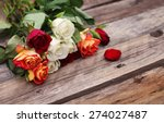 Stock photo a bunch of mixed colors roses over wooden table background 274027487