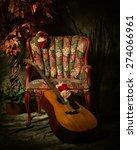 A Vintage Acoustic Guitar Leans ...