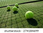 Tennis Balls On Tennis Grass...