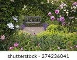 Stock photo bench in a rose garden 274236041
