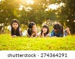 little asian girls laying on... | Shutterstock . vector #274364291