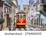 Small photo of LISBON, PORTUGAL - SEPTEMBER 12, 2014: A tram passes the Lisbon Cathedral. The historic trams are a popular attraction.