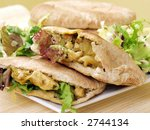 exquisite pita bread with chicken and salad - stock photo