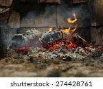 Small photo of Embers and fire above firebrand in hearth, shallow DOF