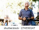 senior man with camera in city | Shutterstock . vector #274550147