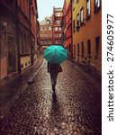 Woman With Umbrella Walking On...
