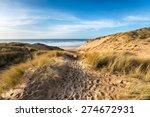 A Path Leading Through Sand...