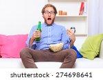 surprise man in front of tv... | Shutterstock . vector #274698641