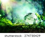 globe resting on moss in a... | Shutterstock . vector #274730429