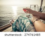 woman drinking cocktail on the... | Shutterstock . vector #274761485