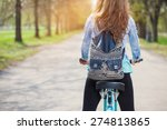 young woman is cycling into the ... | Shutterstock . vector #274813865