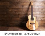 acoustic guitar on wooden... | Shutterstock . vector #275034524