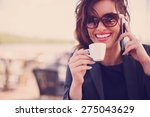 young woman at cafe drinking... | Shutterstock . vector #275043629