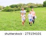 family of four running in... | Shutterstock . vector #275154101
