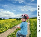 five year old boy on a bike on... | Shutterstock . vector #27518551