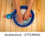 Female Hands Washing In Bucket...
