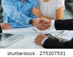 Small photo of Close-up image of real estate agent and his client shaking hands