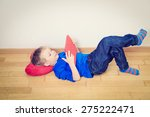 little boy looking at touch pad ... | Shutterstock . vector #275222471