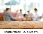 wood table top with blurred... | Shutterstock . vector #275225591