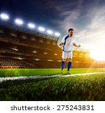 soccer player in action on... | Shutterstock . vector #275243831
