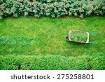 wheelbarrow full while the... | Shutterstock . vector #275258801