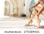 old town and woman legs  | Shutterstock . vector #275289431