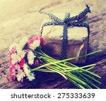 Flowers And Present Gift On...
