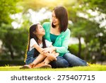 happy young mother with her... | Shutterstock . vector #275407715