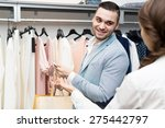 shop girl helping client to... | Shutterstock . vector #275442797