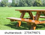 Picnic Table On A Green Meadow