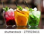 Stock photo glasses of cocktails on bar background 275523611