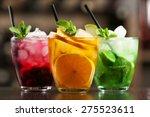 Glasses Of Cocktails On Bar...