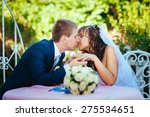 bride and groom posing at the... | Shutterstock . vector #275534651