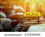 Small photo of Taxi sign on car