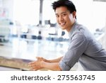 portrait of young man in office ... | Shutterstock . vector #275563745