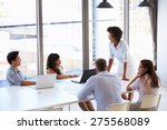 businesswoman presenting to... | Shutterstock . vector #275568089