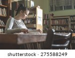 student girl in a library.... | Shutterstock . vector #275588249
