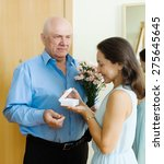 mature man giving jewel in box... | Shutterstock . vector #275645645