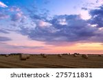 sunset over farm field with hay ... | Shutterstock . vector #275711831