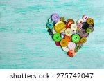 Sewing Buttons Heart On Wooden...