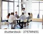 colleagues at an office meeting | Shutterstock . vector #275789651