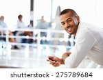 portrait of man in office with... | Shutterstock . vector #275789684